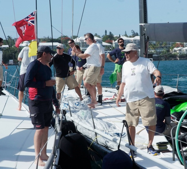 Hap Fauth, owner/driver of Bella Mente, congratulates George Sakellaris, owner of Shockwave upon arrival at the Royal Bermuda Yacht Club. (Photo Credit: Barry Pickthall/PPL)